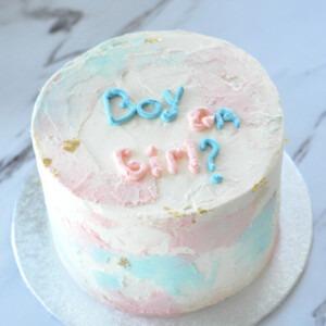 roze-blauw taarten met tekst Boy or Girl in het blauw en roze